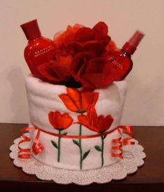 Spa Towel Cake with Bath Towel and Avon Sensual Moments Products - The Flourless Bakery