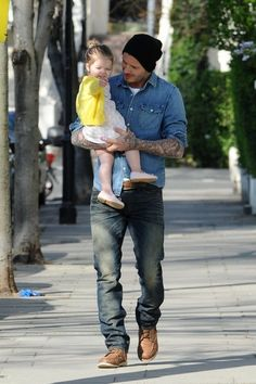 David Beckham - David Beckham Carries His Daughter in London
