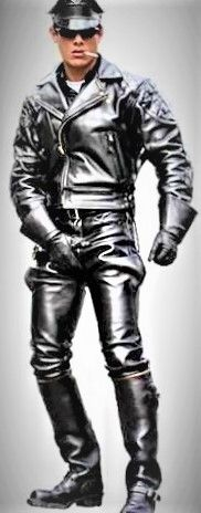 Good looking leather-man with crotch grabbing stance.
