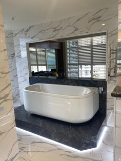 600x600 Rectified Gloss White Marble Look Glazed Porcelain Tile Installed by Dream Tiling Marble Look Tile, Black Marble, Tile Installation, Tiling, Travertine, Porcelain Tile