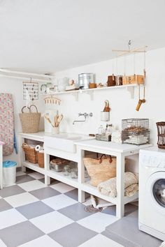 A cozy utility room that utilizes white and plenty of wicker baskets. get #organized #laundry #utility