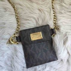 Michael Kors chained waist pouch. Worn once, great condition. Michael Kors Bags Clutches & Wristlets