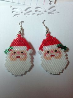 These beadwoven earrings are made with delica seed beads. They measure approx. 2 long including the silver finish stainless steel ear wires. Design by Liz Duffey. If you would like a more textured beard please see my other Santas. Beaded Christmas Ornaments, Christmas Earrings, Christmas Jewelry, Beaded Earrings Patterns, Seed Bead Patterns, Beading Patterns, Crochet Applique Patterns Free, Brick Stitch Earrings, Beaded Crafts