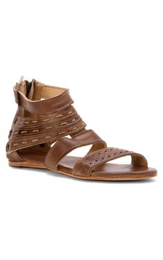 Artemis by Bed Stu  Add a touch of whimsy to your sandal collection with the ARTEMIS. This playfully designed sandal has a padded leather foot bed for a comfortable step. Delight in warm days with the Artemis.