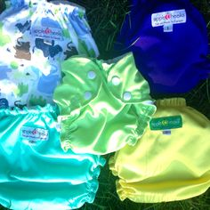 A group of our firsts: first swim, pattern, HTF, reveal and fav. So many AppleCheeks cloth diapers to love.