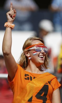 A Netherlands fan waits for the 2014 World Cup Group B soccer match between Australia and Netherlands at the Beira Rio stadium in Porto Alegre