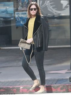 Showing off her fashion credentials: Mandy Moore looked stylish in a leather moto jacket a...