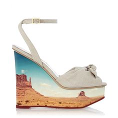 Panoramic Miranda's spectacular canyon print wedge gives this Charlotte Olympia signature classic a captivating new look. Bring some desert essence to your ensembles this season with this playful sandal.