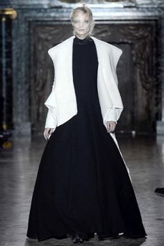 Gareth Pugh - Fall 2013, RTW This look features exaggerated shoulders and the cone silhouette of the Northern Renaissance