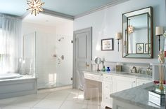 Gray trim bathroom transitional with ghost chair paneled walls dressing table