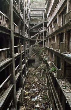 Abandoned city - Hashima Island, Japan. if any of you ever are super bored and have an interest in old, creepy, abandoned places, ive read into this place before. a whole island in japan, jam-packed with people, just abandoned. pictures are creepy and SO cool. sorry for being a nerd :)