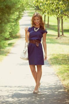 classy! Navy dress, pearls, brown belt, white shoes and purse.