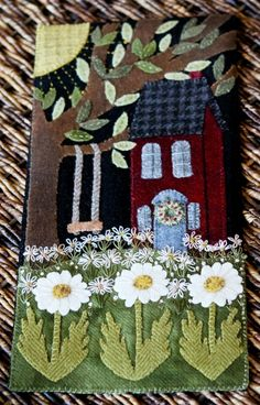 Like: the daisies, both wool and embroidered, and the swing.