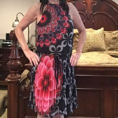 Desigual multi-colored dress Black/Multi colored print, pleated dress. Drawstring at the waist and tie at back of neck to adjust the fit. 100% polyester and very feminine dress. Perfect for a party, graduation, bridal shower and much more. Desigual Dresses