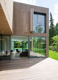 """Artificially grayed larch """"CC"""" house, designed by the studio lynx architecture, Munich Mews House, Timber Cladding, Wood Architecture, House Roof, House In The Woods, Exterior Design, New Homes, House Design, Building"""