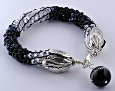 Gorgeous Japanese Kumihimo Bracelet in Black and Crystal Clear Czech Crystals with Fancy Bead Dangle at Clasp. $52.00, via Etsy.