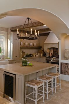 love the white, cream and weathered exposed wood beams