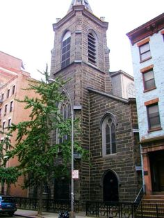 LeBrun's 1870 sanctuary nestled up against the original 1847 facade, seen here before the 2005 dismemberment -- photo nyago.com