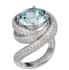 Cartier Trinity ring in aquamarine, white gold, diamond paved.\