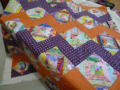 string quilt with marvelous Streak of Lightening zigzag sashing (polka dots!)