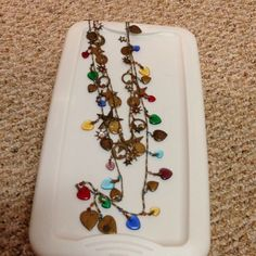 Sold! Dangling charm necklaces They sound like wind chimes. Lots going on here. Jewelry