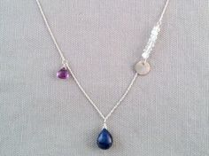 Handmade Necklace with Blue Sapphire, Amethyst, Moonstone, Silver disc by Indiana jewelry artist, Amber Bryce.