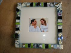 This is a mosaic photo frame I did for Kate and Omri.