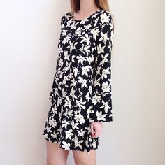 | new | floral longsleeve dress offers welcome new with tag black shift dress with ivory floral print and flowy long sleeves. available in small and medium. LAST SMALL. •870833•  instagram: @xomandysue Everly Dresses Long Sleeve