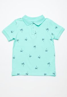Give your little one a timeless and classic style with this sleek golf shirt. Its sleeves are made with elasticated cuffs and it has a three-button design, as well as a beach-ready palm print. Pair it with white jeans and low top All Stars. Beach Ready, Golf Shirts, Palms, Classic Style, White Jeans, Mint, Boys, Sleeves, Mens Tops