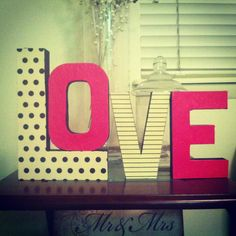 Cute little valentines craft! All I did was paint the sides of the letters black and then modge  podge the craft paper.  Turned out so cute