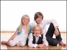 A nice and colourful portrait of three siblings, taken at one of our approved studios.