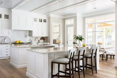 Amazing kitchen features white shaker cabinets paired with cream marble countertops and a white subway tiled backsplash laid out in a herringbone pattern. White Shaker Cabinets, White Kitchen Cabinets, Painting Kitchen Cabinets, Kitchen Cabinetry, Kitchen Units, Kitchen Paint, Benjamin Moore Kitchen, Grey Bar Stools, White Subway Tile Backsplash