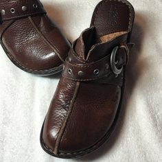 Born Leather Shoes This pair of brown Leather Born Clogs are a size 7 and are in great condition.  They show minimal wear as shown in pictures. Super comfortable. That have a decorative buckle on the top Born Shoes Mules & Clogs