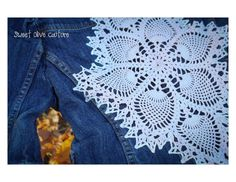 """One of a kind, restyled, fitted denim jacket. Size X-small. Cream/white doily embellishment on back. Three quarter length sleeves . Unique sparkle three button closure.  Shoulder 13"""" Chest 28"""" Front length 19"""" Arm Length 15"""""""