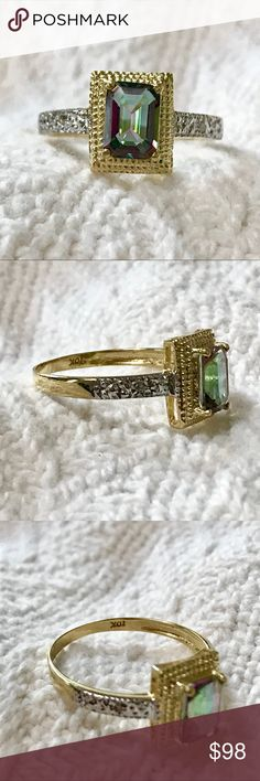 Solid 10k gold emerald cut mystic topaz ring Gorgeous genuine mystic topaz ring with diamond accents.  The large mystic topaz is emerald cut, 5mm x 7mm and weighs approximately 1.1 carats.  There is a diamond on each side measuring 1mm each.  The ring is solid 10k yellow and white gold, stamped 10k.  The ring is a size 7 and weighs 1.4 grams.  New without tags. Jewelry Rings