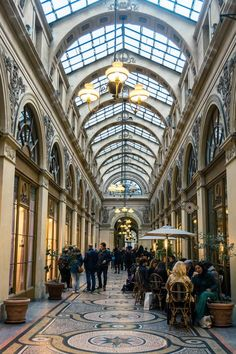 Photo of Galerie Vivienne, one of the covered passages in Paris, and a must-see attraction in Paris for those looking for unusual things to do in Paris. #Travel #Paris #France