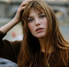 Love her hair, great color and bangs.