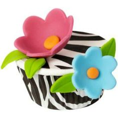 Zebra stripe cupcakes decorated with fondant and sugar shets. Fun and and colorful.
