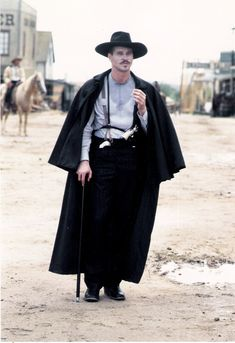 Val Kilmer as Doc Holliday in Tombstone Tombstone Quotes, Movies Showing, Movies And Tv Shows, Doc Holliday Tombstone, O Cowboy, The Lone Ranger, Tv Westerns, Western Movies, American Frontier