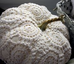 Crochet doilie covering a pumpkin.  Who would have thought?  So cute . . .