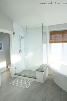 Small Master Bathroom Remodel Ideas - clear glass shower white subway tile