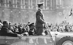 Hitler in 1938, Berlin, with Erich Kempka driving the Mercedes. Seyss Inquart and General Keitel are in the back seat. Both were hanged at Nuremberg.