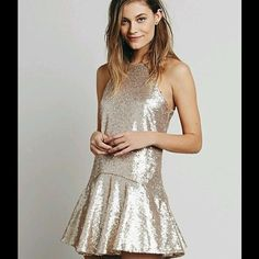 Free People liquid shine mini dress Super cute rose gold sequin dress with matte sequins! New with tag! Never been worn! Free People Dresses Mini
