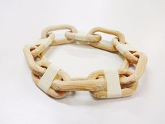 Making a wooden chain is a classic wood carving project. It is traditionally done using simple carving tools to make an unbroken chain from one solid piece of wood....