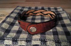 Trestle Leather: Heavy Leather Braid Wristband. $5.00, via Etsy.