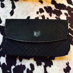Celine AUTHENTIC Large Black Clutch! MSRP $1600 Celine Paris Authentic Large Black Clutch! Retails $1600 and is in great gently used condition. This clutch is larger and more beautiful in person! Many different compartments also. Plenty of room for iPhone6+, tablet, and essentials. Definitely a lifetime piece and investment! Feel free to make a reasonable offer and it's yours! Selling to first reasonable offer I receive! Snatch it up before someone else does! ASAP shipping! All items must…