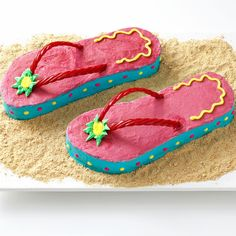 "Flip-Flop Cakes Recipe -I made this cake for a summer birthday party—it would be fun for a beach party or any summer get-together. You could also set a pair of sunglasses on the graham cracker ""sand.""—Renae Calkins, Owosso, Michigan"