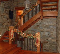 Stairwell warm toned holiday garland decor by Nature of Design with Janet Flowers