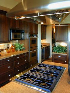 Kitchen with cook top, built in double ovens and microwave.