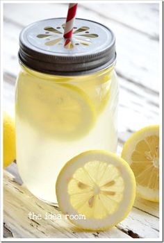 homemade lemonade recipe from The Idea Room & lemon slice mason jar lids from here: http://www.welovecitrusshop.com/product/mason-jars-lemonade-lids